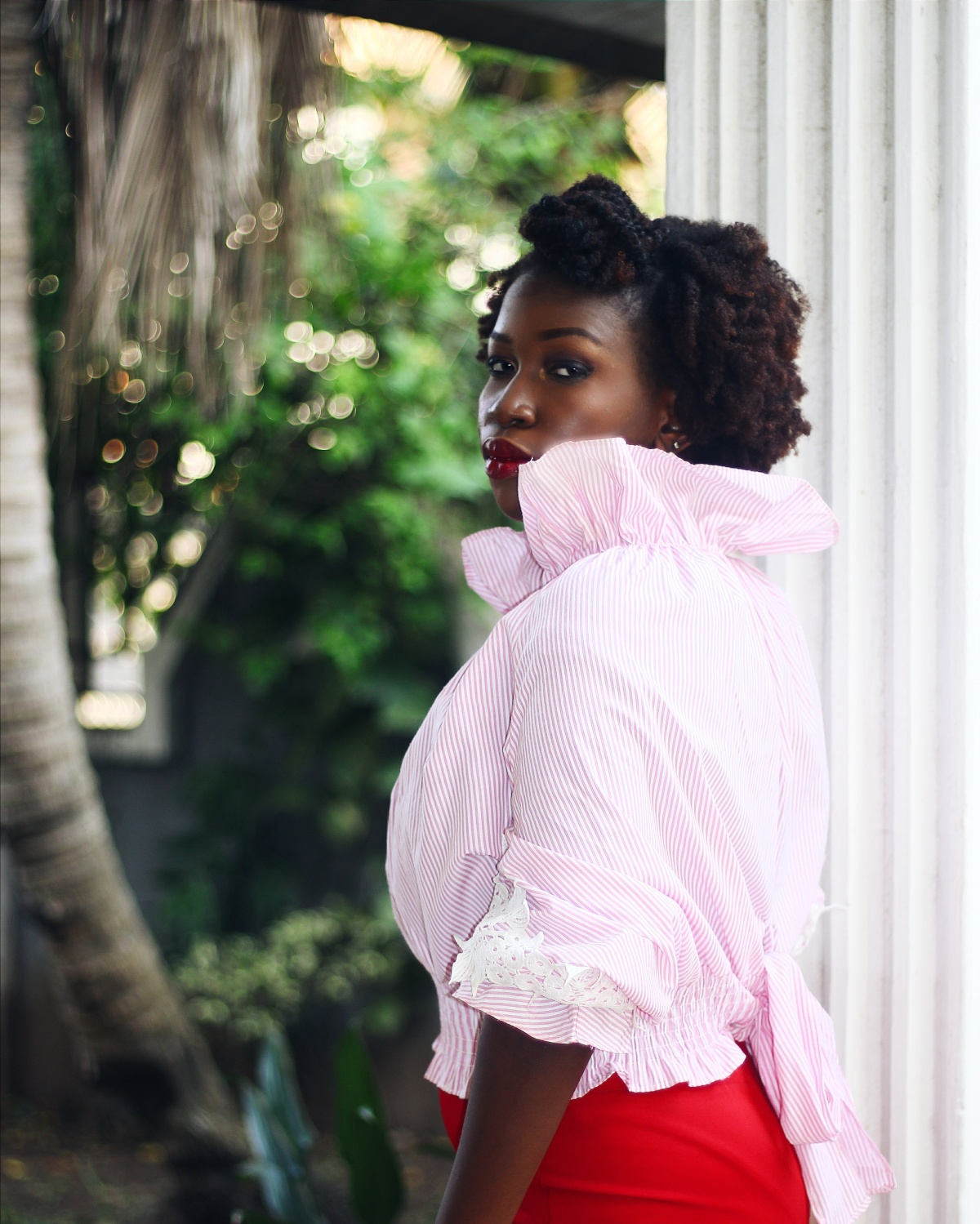 Styling a pink top and red skirt